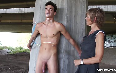 Nympho granny sucks a big cock of tied to naked guy