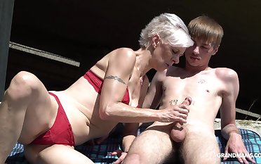 Perverse granny near thongs sucks a big hard penis of one young challenge